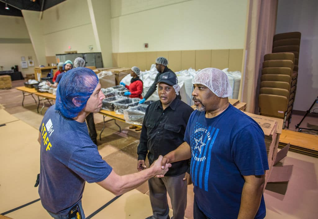 TSHICC Packs Meals To Feed Starving Children Around The World